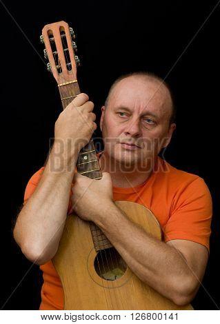 Portrait of mature man - amateur guitarist