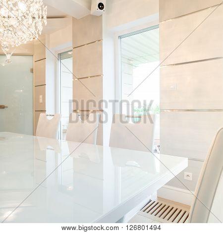 Cristal chandelier in bright dining room interior