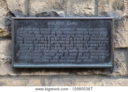 A plaque detailing the location that was once known as Golfers Land along Canongate on the Royal Mile in Edinburgh Scotland.