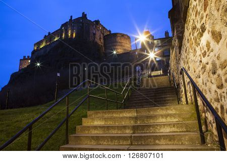 A dusk-time view of Edinburgh Castle and Grannys Green Steps in Edinburgh Scotland.