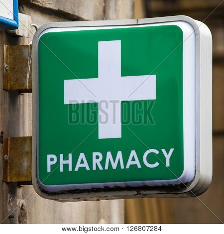 EDINBURGH SCOTLAND - MARCH 9TH 2016: A sign for a Pharmacy on a high street in Edinburgh on 9th March 2016.