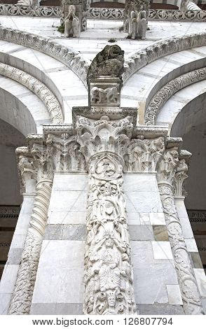 Lucca cathedral facade detali with marble columns and archs