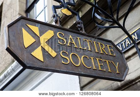 EDINBURGH SCOTLAND - MARCH 12TH 2016: A sign for the historic Saltire Society in Edinburgh on 12th March 2016. The society was set up in 1936 to promote the understanding of the culture and heritage of Scotland.