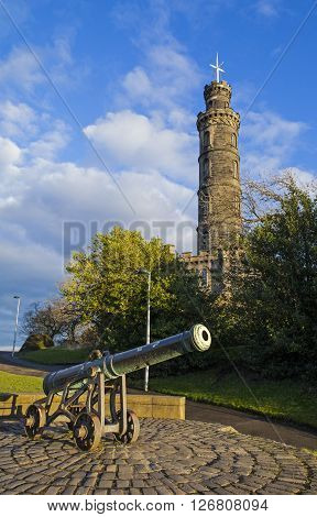A view of the Nelson Monument and a Cannon on Calton Hill in Edinburgh Scotland.