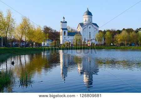 GOMEL BELARUS - APRIL 17 2016: Unidentified people are relaxing near the Church of St. Alexander Nevsky in the recreation area