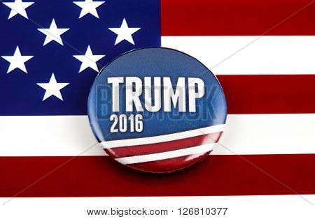LONDON UK - MARCH 3RD 2016: A Trump 2016 pin badge over the US flag symbolising Donald Trump's campaign to become the next President of the United States 3rd March 2016.