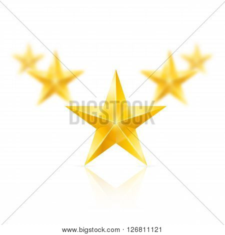 Five gold stars on white background - the first one in focus the others blurry.