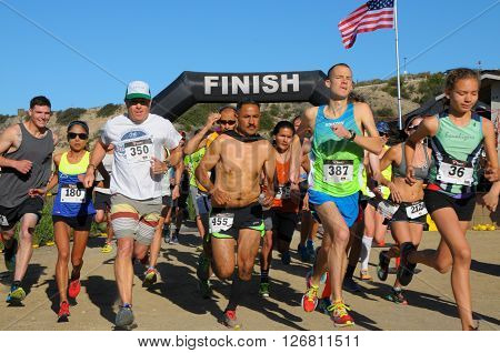 Crystal Cove California/USA-April 16 2016:Runners in the Heroes 6k Trail race