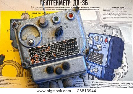 ILLUSTRATIVE EDITORIAL.Vintage Soviet military radiometer DP-3B.For tanks and another transport.Background - poster Soviet Civil Defense: DP-3B,design and usage.At April 19,2016 Kiev, Ukraine