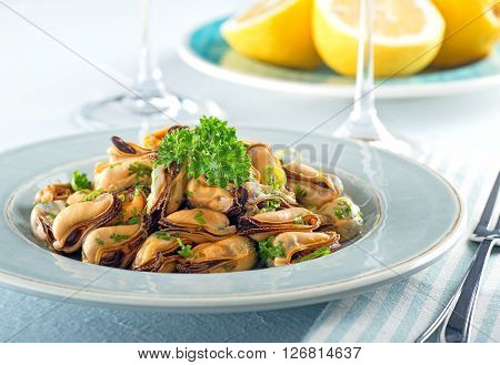 A delicious blue mussel salad with green onions and parsley.