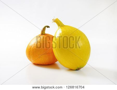 orange and yellow pumpkins on white background