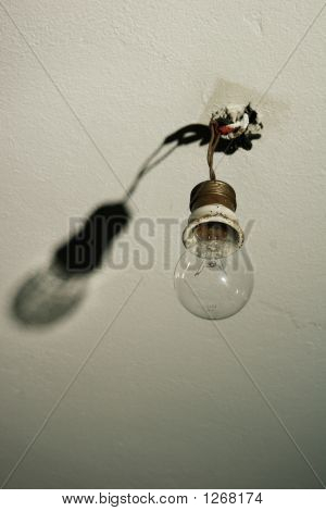 Light Bulb Hanging From Bare Wires