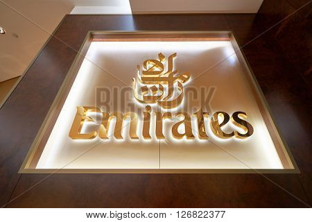 DUBAI, UAE - MARCH 09, 2016: close up shot of Emirates logo. Emirates is the largest airline in the Middle East. It is an airline based in Dubai, United Arab Emirates.