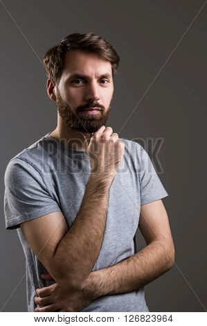 Young Male Hand At Chin