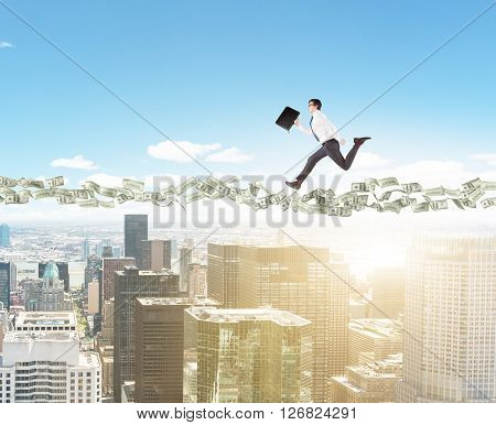Dollar banknote path with running businessman above sunlit New York city