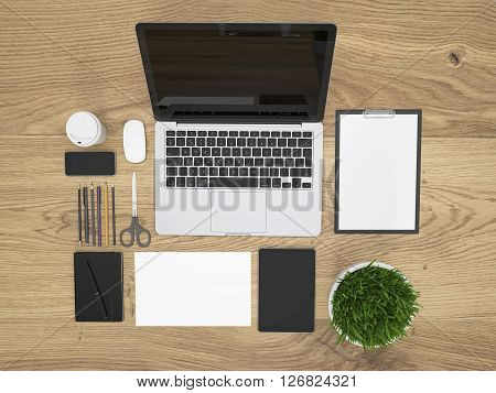 Topview of textured wooden table with blank laptop plant and office tools organized neatly. Mock up 3D Rendering