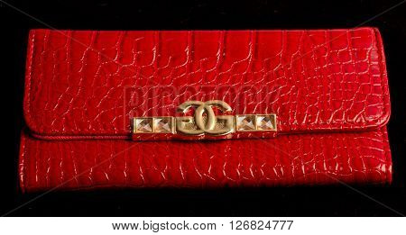 red purse arranged on a black background