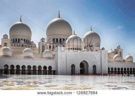 ABU DHABI, UNITED ARAB EMIRATES - APRIL 17, 2014. View of Sheikh Zayed Grand White Mosque in Abu Dhabi, United Arab Emirates.