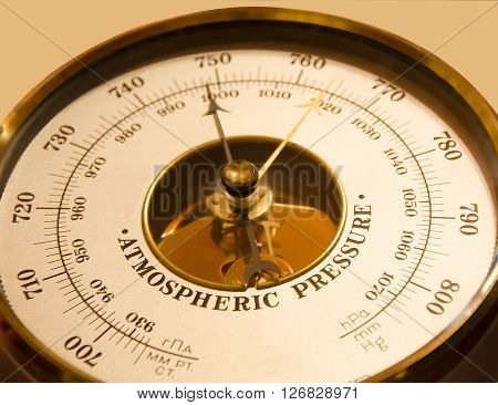Atmospheric pressure of a barometer on a beige backgron ** Note: Soft Focus at 100%, best at smaller sizes