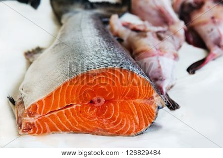 Fresh salmon and seafood at street fish market