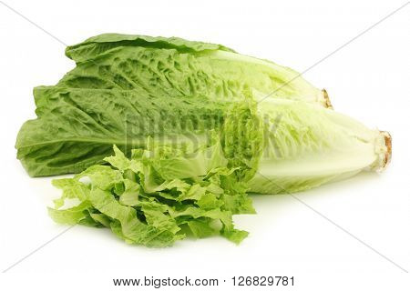 fresh roman lettuce and a cut one on a white background