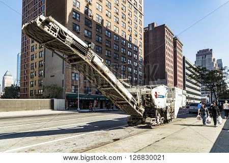 Street View With People And Roadtec Street Machine In New York City