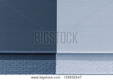 the textured background from corrugated iron and a brick of silvery color and a blank space for the text
