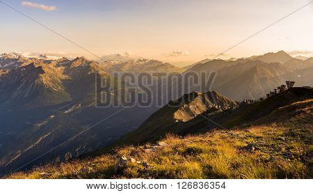 Warm Light At Sunset On Mountain Peaks, Ridges And Valleys