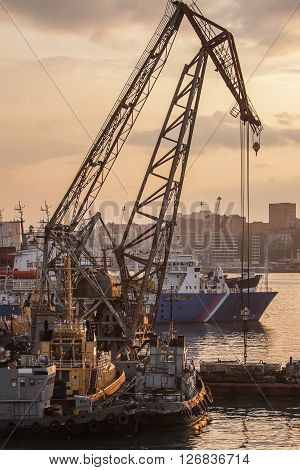 ships and floating crane in the port of Vladivostok in the evening