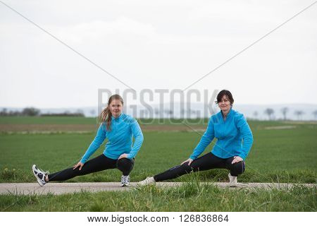 Two Women Stetching Outdoors