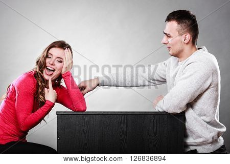 Happy couple having fun and fooling around. Joyful man and woman have nice time. Good relationship.