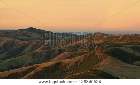 Evening scene on the Banks Peninsula. Hills near Akaroa, New Zealand.