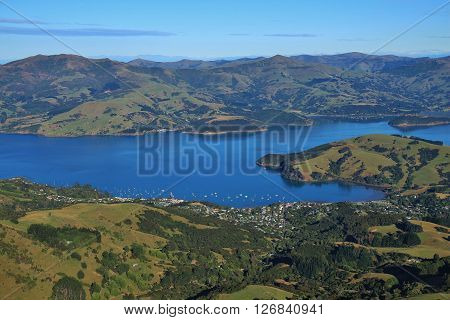 Distant view of Akaroa and Akaroa Harbour. Travel destination near Christchurch, New Zealand.