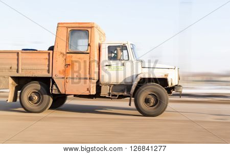 Blurred Moving Russian Industrial Vehicle