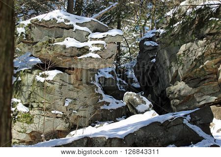 Huge snow covered boulders in the sun and shade.
