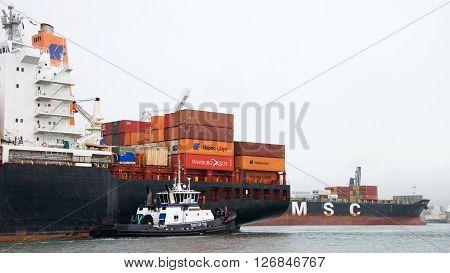 Cargo Ship London Express Entering The Port Of Oakland, Msc Lisa Departing