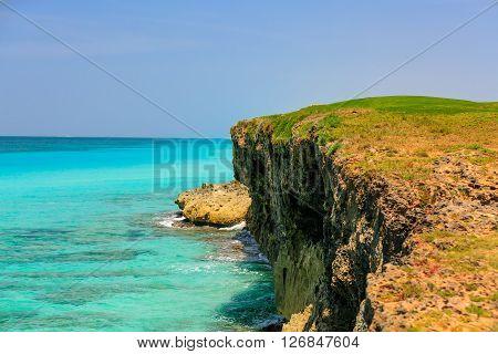 gorgeous amazing beautiful cliff standing in Atlantic tranquil turquoise ocean at Varadero island , Cuba