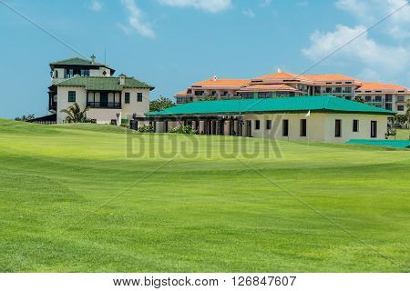 Varadero island, Cuba, Apr 30, 2014: Mansion Xanadu gorgeous, amazing, beautiful inviting view of golf green fresh field with Mansion Xanadu hotel on background