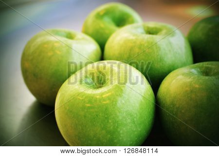 Granny Smith Green Apples on a pewter plate