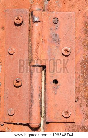 Rusty Orange Door Hinge