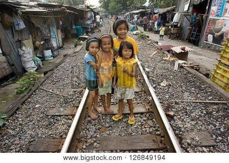 BANGKOK , THAILAND - NOVEMBER, 2005 : There are an estimated 7.3 million people that are considered to be in poverty in Bangkok, Thailand. many families living along the railroad tracks or in slums, in very poor sanitary conditions.