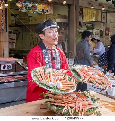 Tokyo Japan - November 13 2015: Tsukiji fish market. Tsukiji is the biggest freshest fish market in the world. Shop around Tsukiji peddling their giant crabs.
