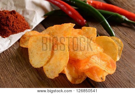 Homemade potato chips with hot pepper spice