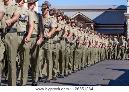 Charters Towers Australia April 25 2015: Anzac Day Parade with soldiers marching down main street of town.