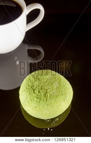 Traditional Japanese mochi dessert on a black background