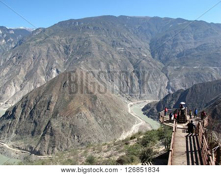 LIJIANG CHINA - OCT 21 : Unidentified tourist at First bend of yangtze river in Lijiang Yunnan China on October 21 2015
