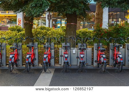 YOKOHAMA JAPAN - NOVEMBER 24 2015: Bay Bike is a bicycle sharing system that has docking ports in designated areas managed by Docomo Japan's biggest private telecommunicatiom company