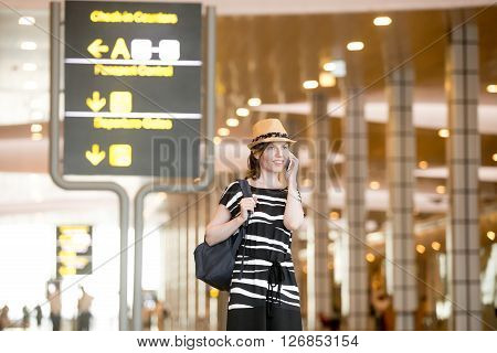 Woman Making Call In Airport