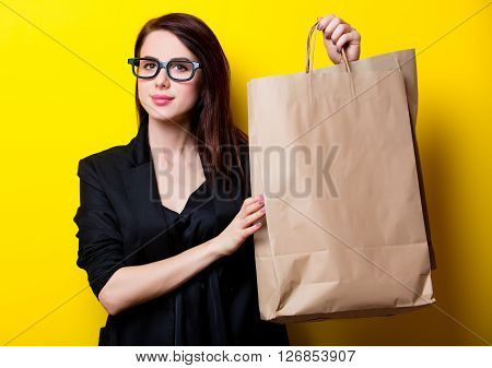 Portrait Of The Young Woman With Shopping Bags