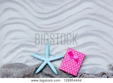 Starfish, Gift And Fishnet On The Sand
